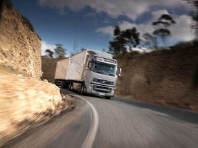Contract lorry driver negotiating a mountain road